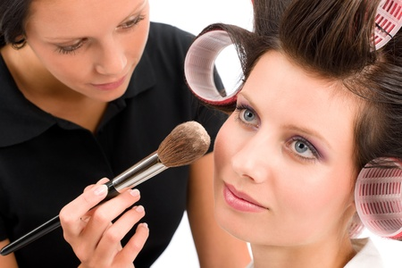 hair curler: Make-up artist woman fashion model apply powder blush rouge brush Stock Photo