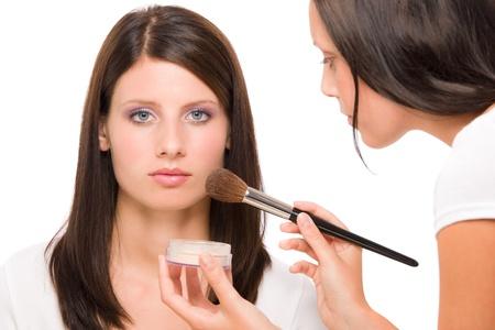 rouge: Make-up artist woman fashion model apply powder blush rouge brush Stock Photo