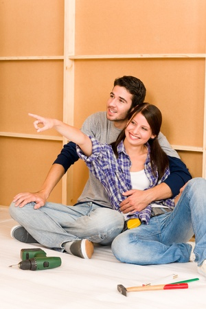 Home improvement young happy couple repair tool relax on floor photo