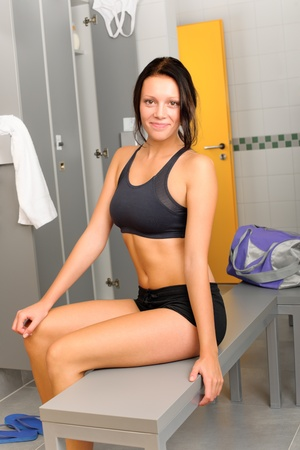 Locker room young sportive woman sitting smiling fitness training photo