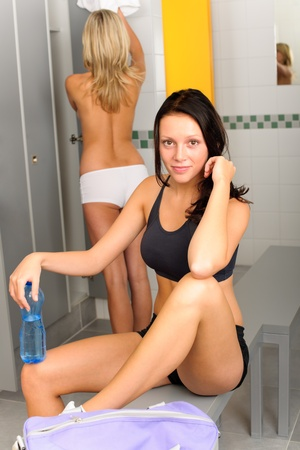 Locker room young sportive woman outfit sitting fitness training photo