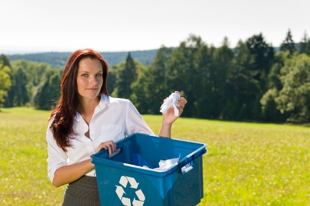 recycle sign: Recycling paper box young businesswoman attractive in sunny meadow Stock Photo