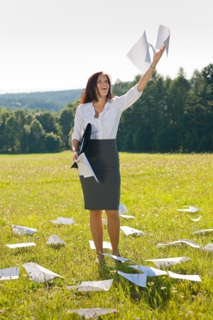 Young businesswoman sunny meadows attractive smiling throw papers freedom Stock Photo - 10459698
