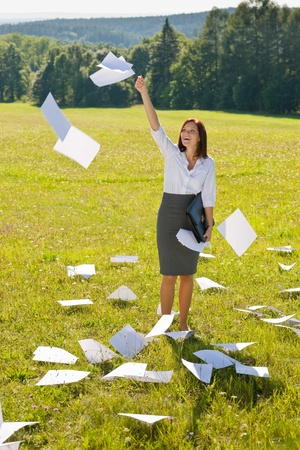 throw paper: Young businesswoman sunny meadows attractive smiling throw papers freedom Stock Photo