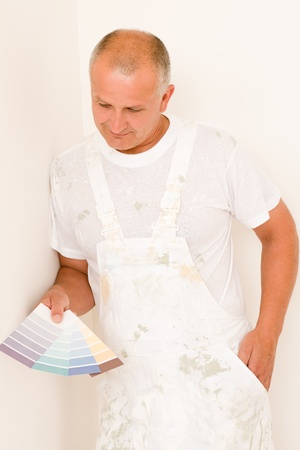 Home decorating mature male painter choose color swatches Stock Photo - 10501292