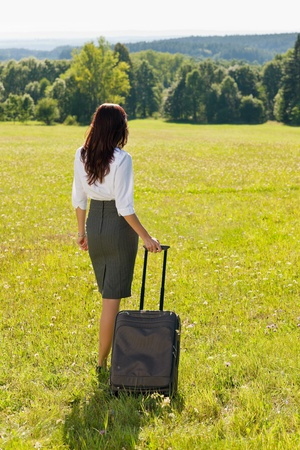 Young businesswoman sunny meadows attractive with suitcase luggage Stock Photo - 10520085