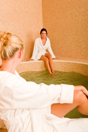 Relax bath healthy spa two beauty woman sitting bathrobe pool Stock Photo - 10520073