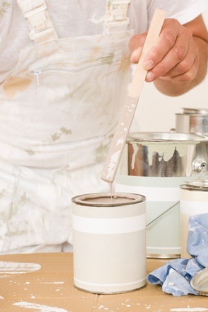 Home decorating close-up male mixing up paint color in can Stock Photo - 10520056