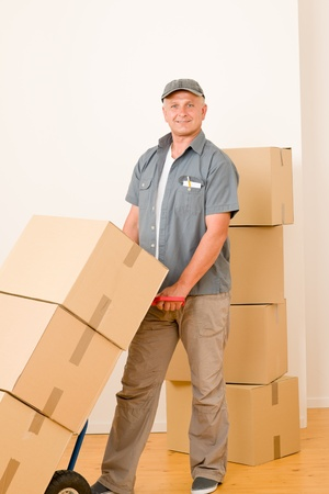mover: Friendly messenger or mover delivering parcel boxes on hand truck