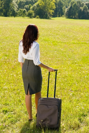 Young businesswoman sunny meadows attractive with suitcase luggage Stock Photo - 10548409