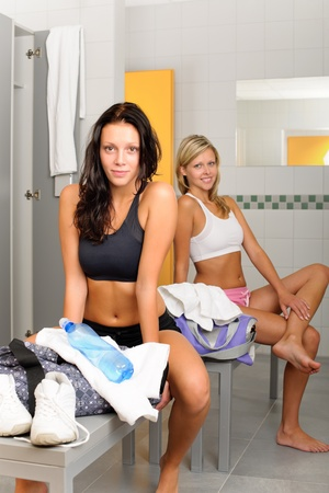 Locker room two sportive happy women sitting fitness training equipment Stock Photo - 10562106