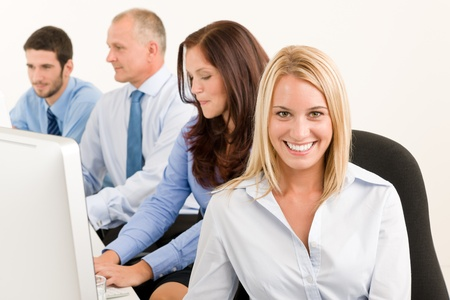 Business team attractive woman sit in line behind computer table Stock Photo - 10562076
