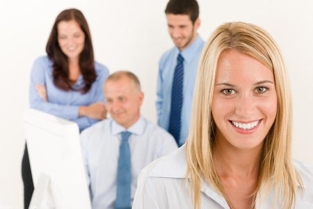 Business team close-up of pretty businesswoman with attractive happy colleagues photo
