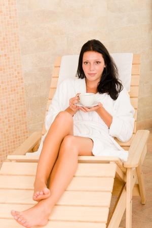 Relax luxury spa beauty woman drink coffee wear bathrobe lying sun-bed photo