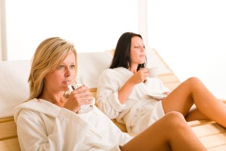 Relax luxury spa beauty women enjoy refreshments lying on sun-beds photo