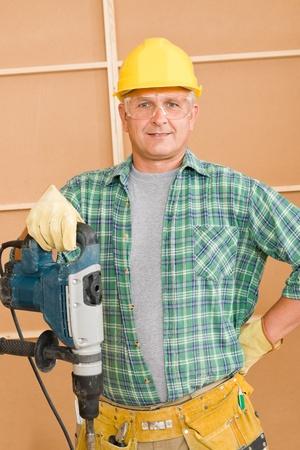 presslufthammer: Handwerker Reifen Hauptverbesserung arbeiten mit Presslufthammer diy Lizenzfreie Bilder