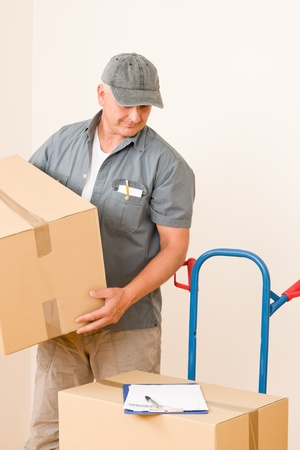 Messenger mature male courier delivering parcel boxes. Shipping and logistics. photo
