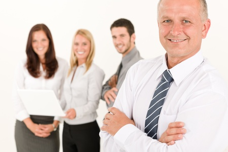 Business team mature man with happy colleagues posing in back photo