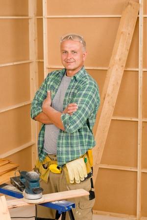 Handyman mature professional diy working on new home improvement photo