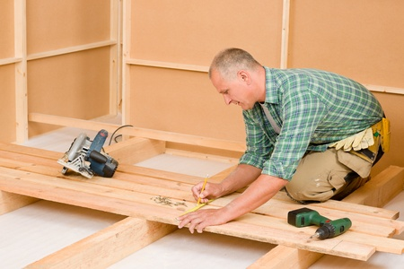 50 55 years: Mature handyman home improvement installing wooden floor in new house