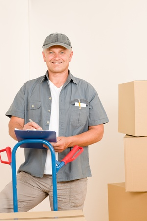 mover: Messenger mature male courier delivering parcel boxes. Shipping and logistics.