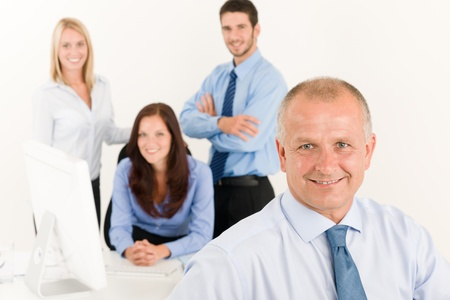 management meeting: Business team close-up of senior businessman with attractive happy colleagues Stock Photo