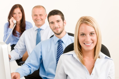 Business team attractive woman sit in line behind computer table photo