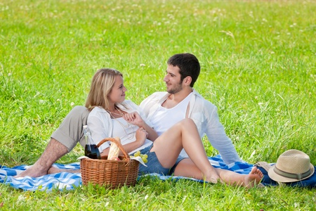 Picnic - Romantic happy couple in meadows nature  sunny day photo