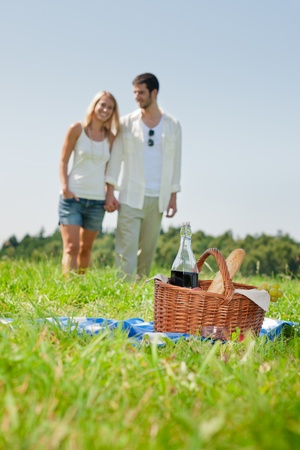 Picnic basket - Romantic happy couple in meadows nature sunny day photo