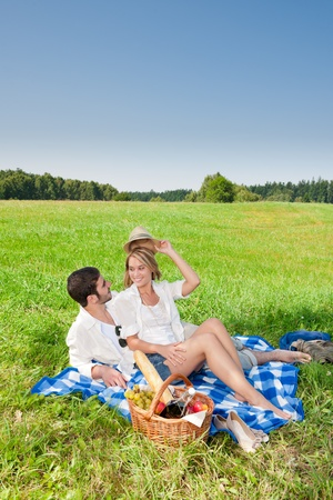 amorous woman: Picnic - Romantic happy couple in meadows nature  sunny day
