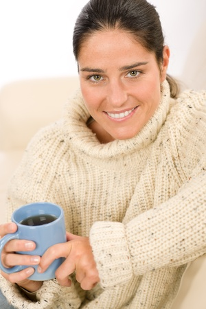 woolly: Happy woman with coffee cup wear pullover on white background