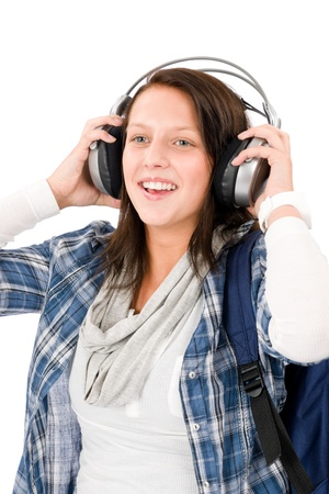 Smiling female teenager enjoy music with headphones and baseball cap Stock Photo - 10795377