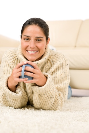 Winter portrait of happy woman with coffee cup wear pullover photo