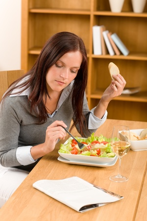 beautiful salad: Healthy lunch at home attractive woman read magazine eat salad Stock Photo