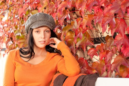 Autumn leaves park scenery young woman relax sitting on bench photo