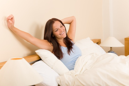 waking up: Bedroom - beautiful woman morning waking up stretching on white bed Stock Photo