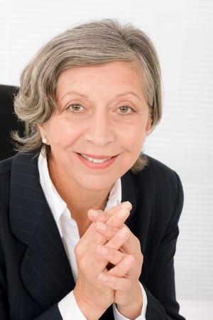 Successful senior businesswoman professional portrait watch camera Stock Photo - 11109696