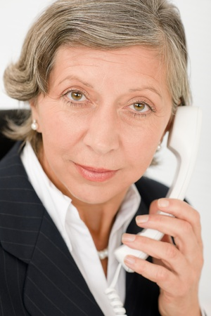 Senior professional businesswoman on phone close-up portrait Stock Photo - 11109687