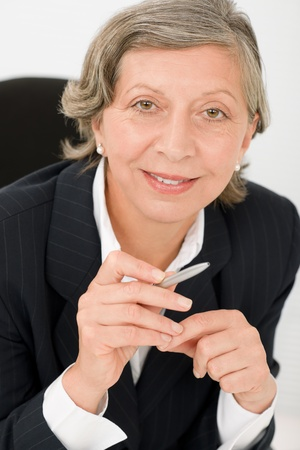 Happy successful senior businesswoman professional smart look holding pen portrait Stock Photo - 11109800