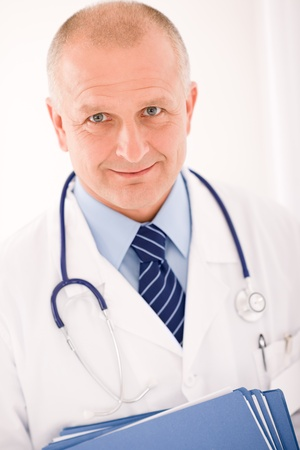 Professional senior doctor male with stethoscope portrait with document folders photo