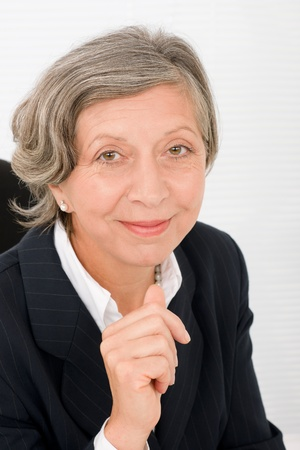 Successful senior businesswoman professional portrait watch camera Stock Photo - 11109970