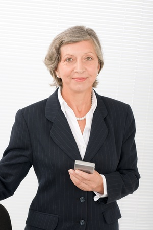 Successful senior businesswoman hold cellphone portrait Stock Photo - 11109968