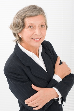Successful senior businesswoman crossed arms professional portrait watch camera Stock Photo - 11109964