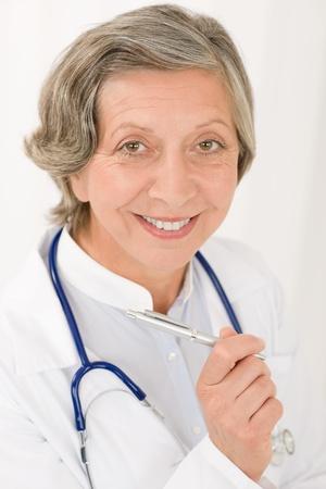 Smiling senior doctor female with stethoscope professional portrait photo