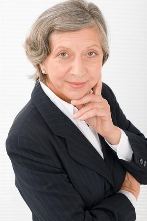 Successful senior businesswoman professional portrait watch camera Stock Photo - 11109996