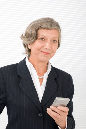 Successful senior businesswoman hold cellphone portrait Stock Photo - 11148579