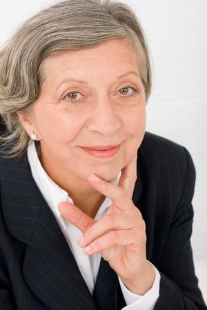 Successful senior businesswoman professional portrait watch camera Stock Photo - 11174408