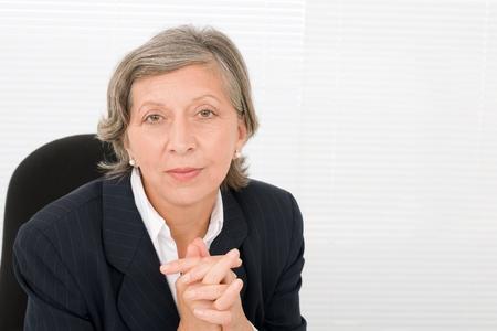 Successful senior businesswoman professional portrait watch camera Stock Photo - 11174402