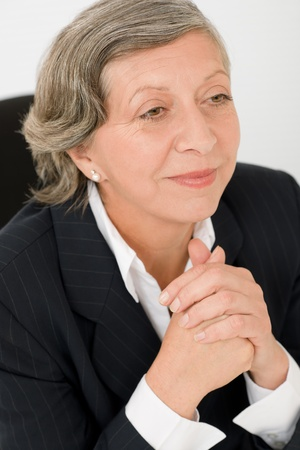 Successful senior businesswoman professional portrait looking aside Stock Photo - 11287877