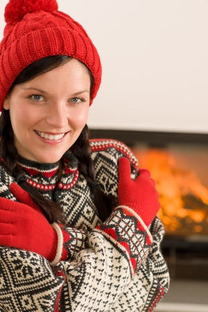 Winter christmas happy woman with hat and gloves by fireplace Stock Photo - 11288021